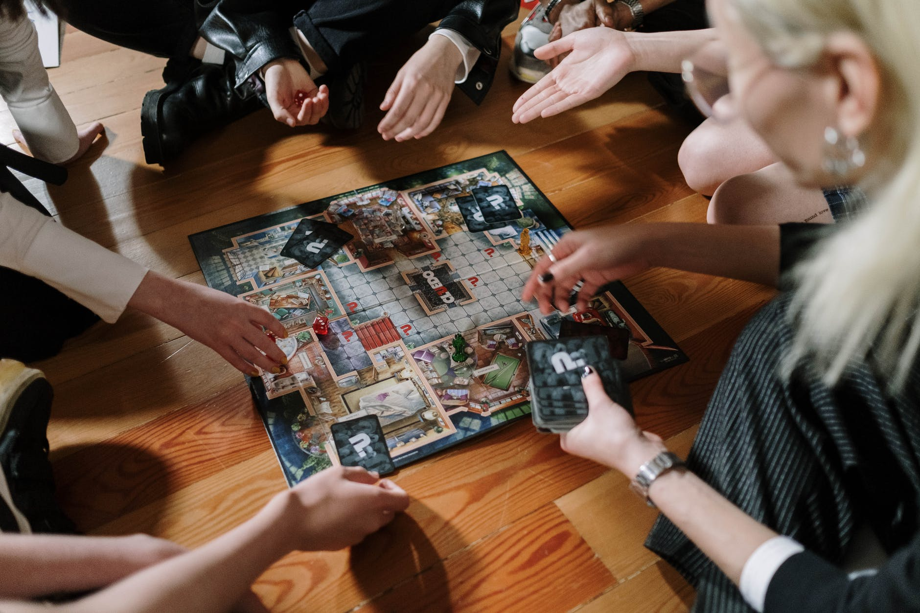 people playing game on brown wooden table